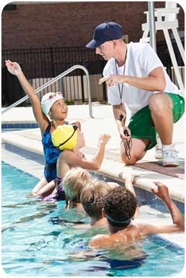 Counselor with campers in pool
